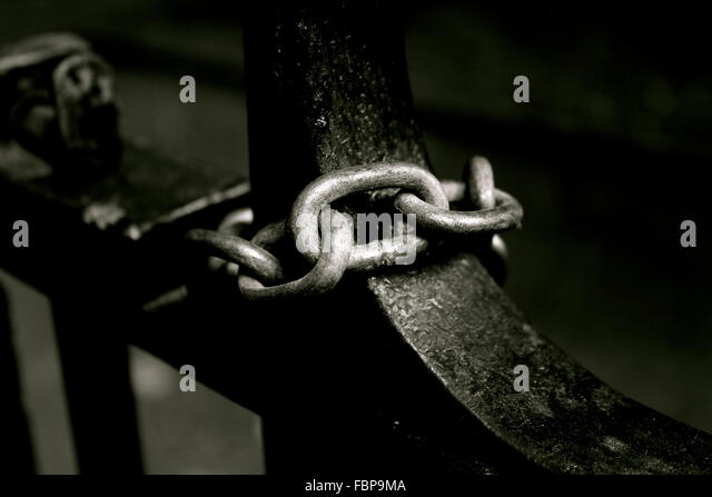 Metallic Chain Tied On Fence - Stock Image