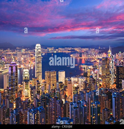Hong Kong skyline illuminated at twilight, square format. - Stock Image