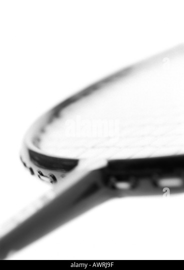 Badminton racket, blurred, close-up, b&w. - Stock Image