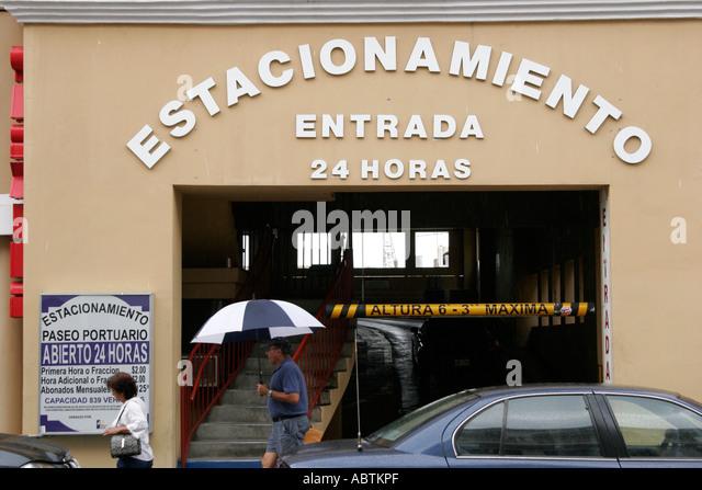Puerto Rico Old San Juan Calle Recinto Sur public parking garage Spanish language umbrella - Stock Image