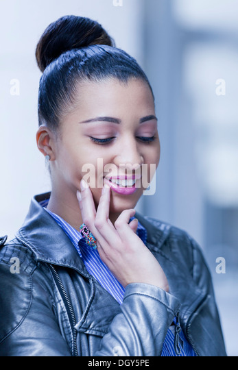 Shy African-American woman - Stock Image