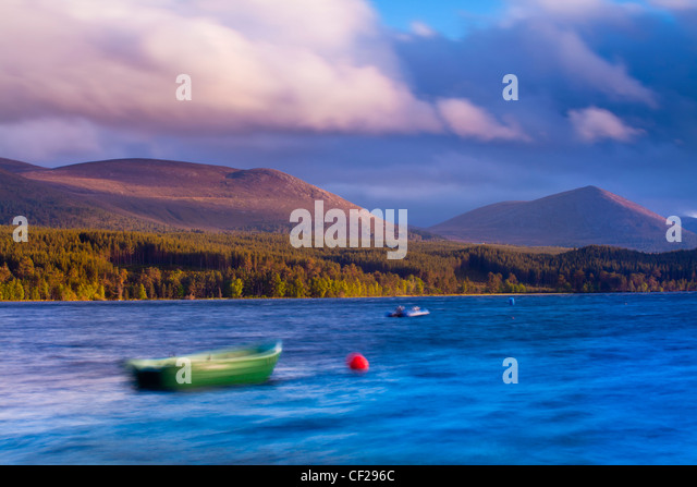 A stormy evening on Loch Morlich with the Cairngorm Mountain Range in the distance. - Stock Image