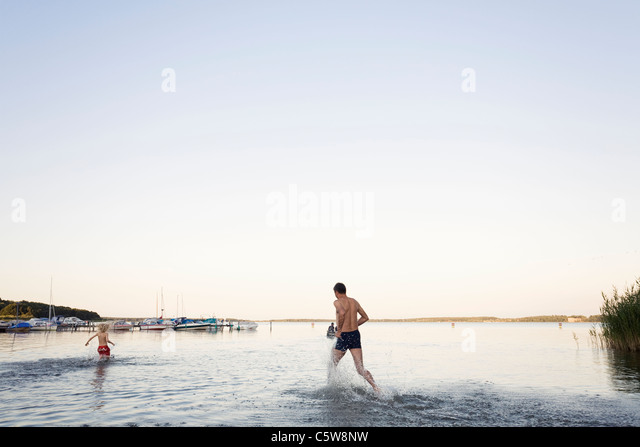 Germany Western Pomerania Father and son enjoying at fleesensee lake - Stock Image