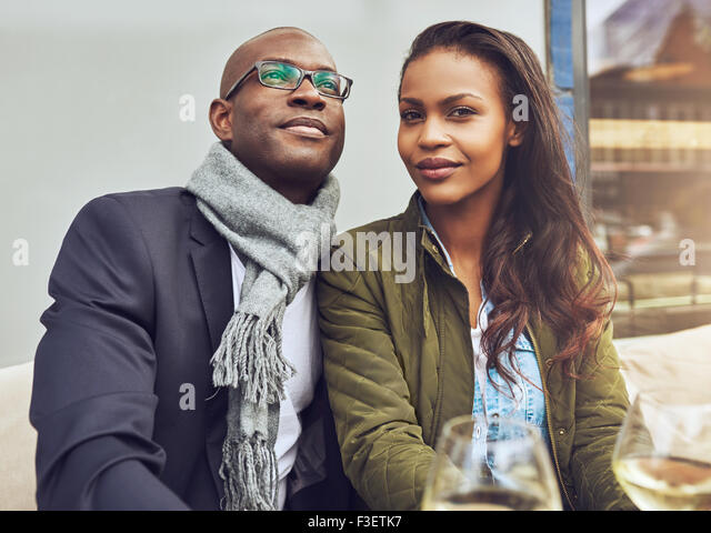 Black couple enjoying life and dating, trendy dressed - Stock Image