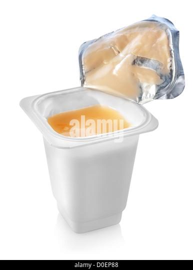 Open yogurt isolated on a white background - Stock Image