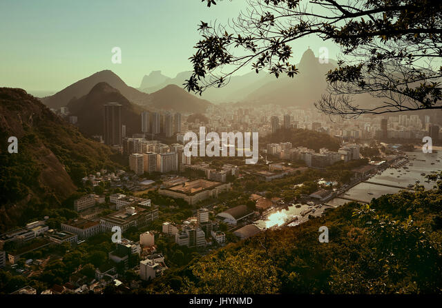Views of Rio de Janeiro and Christ the Redeemer from Sugarloaf mountain (Pao de Acuca) at sunset, Rio de Janeiro, - Stock Image