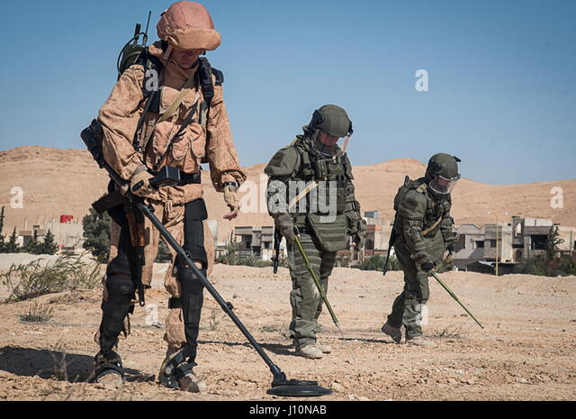 Palmyra, Syria. 18th Apr, 2017. A Russian military engineer use mine detectors during a mine clearing operation - Stock Image