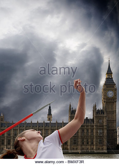 Javelin thrower by houses of parliament - Stock Image