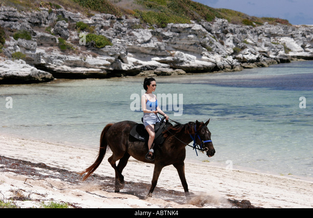 Grand Turk Atlantic Ocean Indigenous Horse Shelter horseback riding rocky cliff beach - Stock Image
