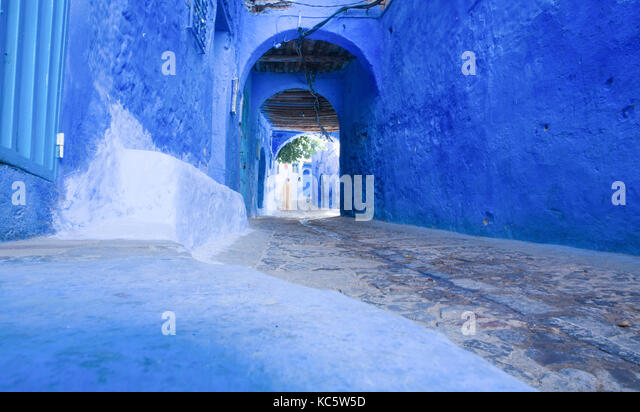 Unrecognizable natives on traditional moroccan architectural details in Chefchaouen, Morocco, Africa - Stock Image