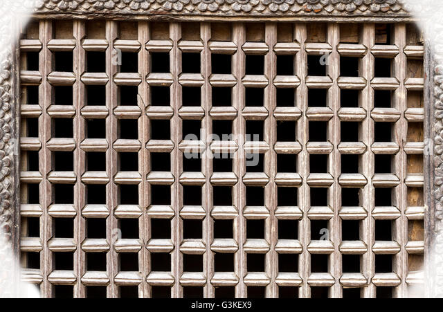 Wooden ancient Nepalese window texture background or pattern - Stock Image