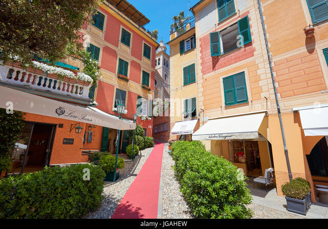 Portofino Italian village with colorful houses facades and luxury shops like Loro Piana e Salvatore Ferragamo - Stock Image