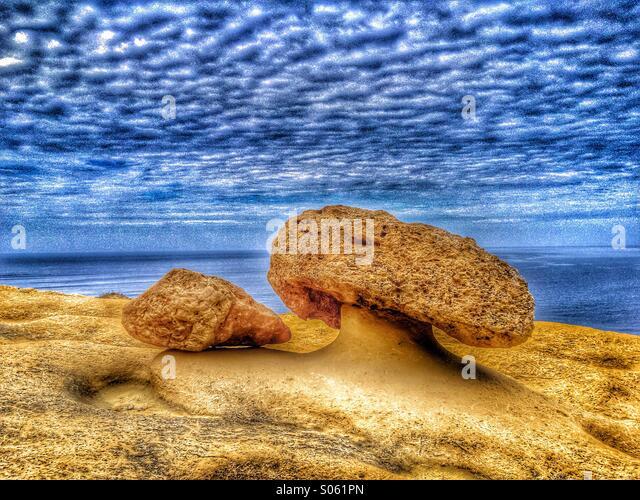 Weathered limestone rock in a mushroom shape - Stock Image