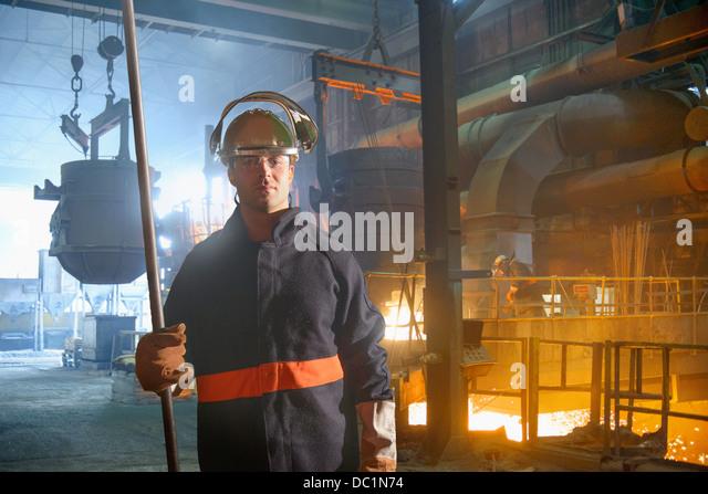 Portrait of steel worker in steel foundry - Stock Image
