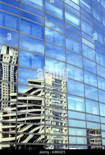 Buildings reflected in window panes of skyscraper - Stock-Bilder