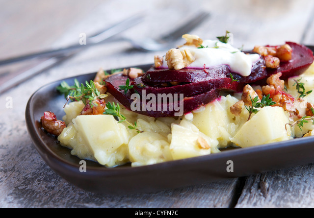 Risotto with parsnip, beets and walnuts. - Stock Image