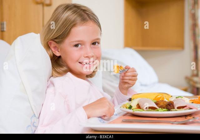 Young Girl Eating Hospital Food - Stock-Bilder