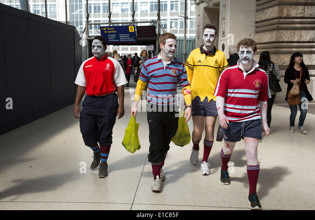 People dressed up in crazy zombie costumes at Waterloo station on their way to the Rugby Sevens tournament. London, - Stock Image