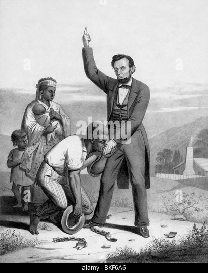 Vintage print circa 1862 depicting US President Abraham Lincoln being kissed on the hand by a freed slave. - Stock Image