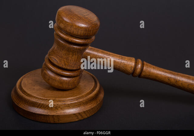 Wooden brown Judges gavel or auction hammer - Stock Image