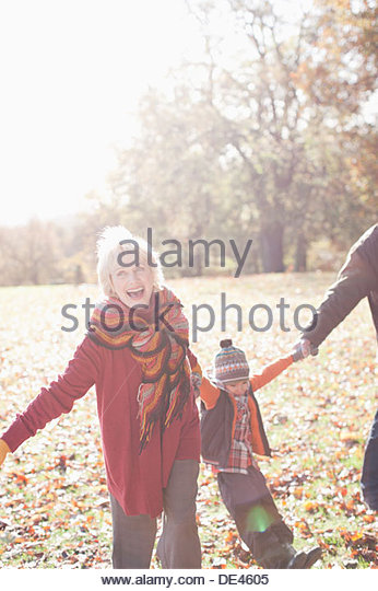 Grandparents playing in park with grandson - Stock Image