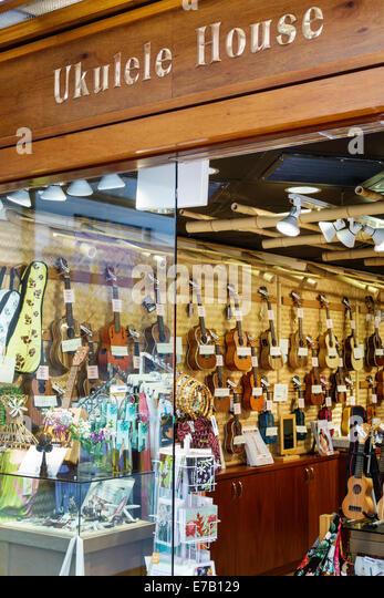 Hawaii Hawaiian Honolulu Waikiki Beach Ukulele House musical instruments sale display front entrance Pualeilani - Stock Image