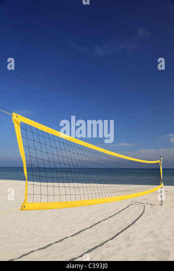 Abandoned beach volleyball net - Stock Image