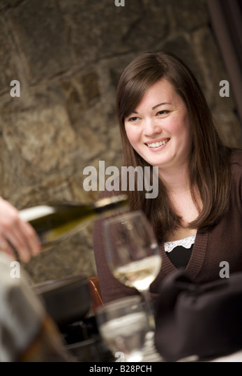 Young couple enjoying a fine dinning experience Whistler Village British Columbia Canada - Stock Image