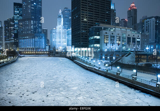 USA, Illinois, Chicago, Frozen river in city at night - Stock Image