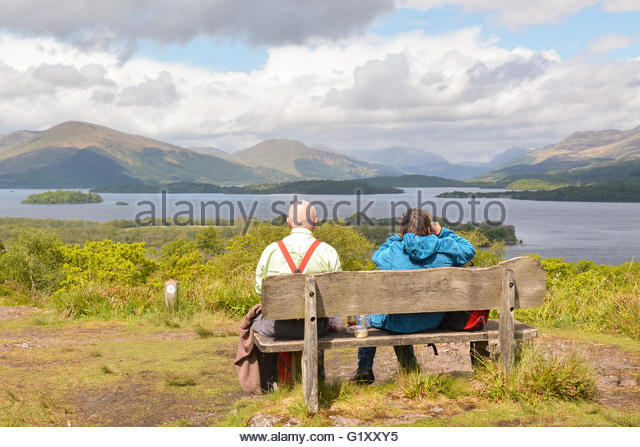 Inchcailloch, Loch Lomond, Scotland, UK. 20th May 2016. UK Weather: a couple took advantage of a dry day with sunny - Stock Image