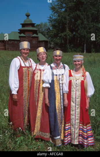 Russia former Soviet Union Kostroma Open Air Museum of Wooden Architecture women wear period costumes - Stock Image