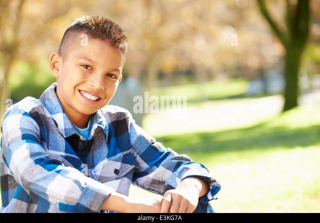 Portrait Of Hispanic Boy In Countryside - Stock Image