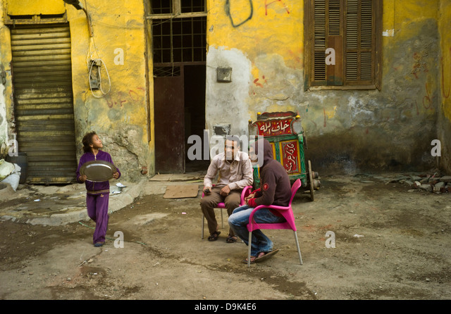 Two men sit in an alleyway in the, Bein al-Qasreen area, Islamic Cairo, Cairo, Egypt - Stock Image