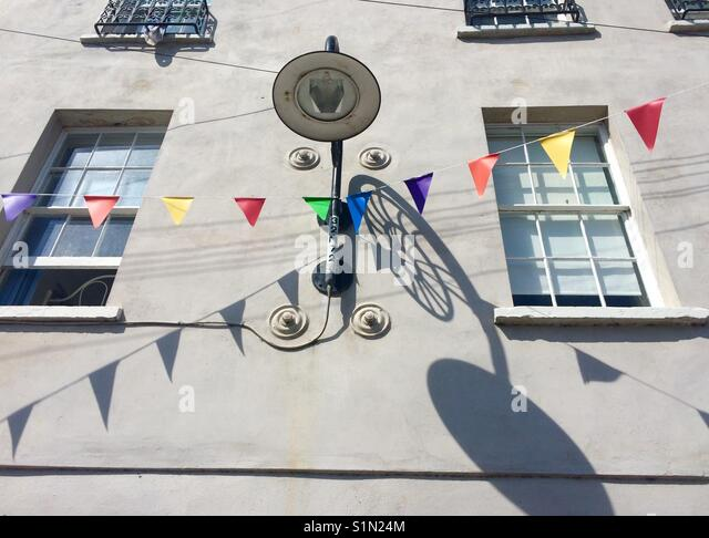 Lamp and bunting Lyme Regis - Stock Image