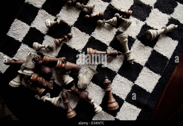 Game pieces on furry chess board - Stock Image