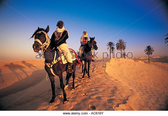 Bedouin Horsemen Tunisia - Stock Image