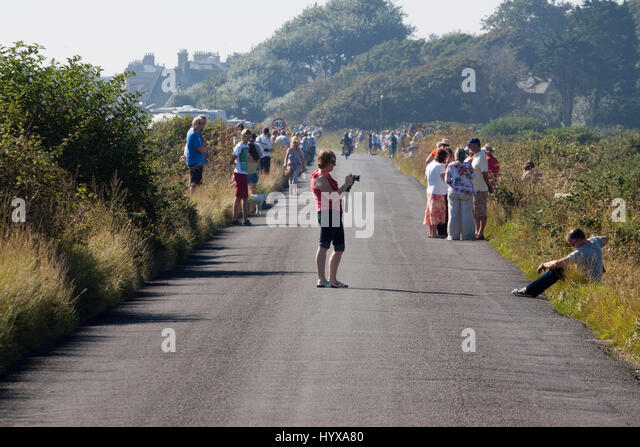 Spectators waiting for the Tour of Britain cycle race in Aldeburgh - Stock Image