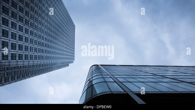 UK, London, Docklands, extreme worms eye view of facades at financal district - Stock Image