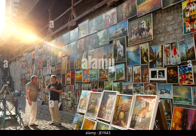 Paintings and artwork on sale in the Old Town of Krakow, Poland, Central/Eastern Europe, June 2017. - Stock Image