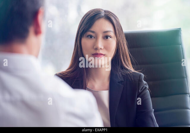 Woman at job interview - Stock Image