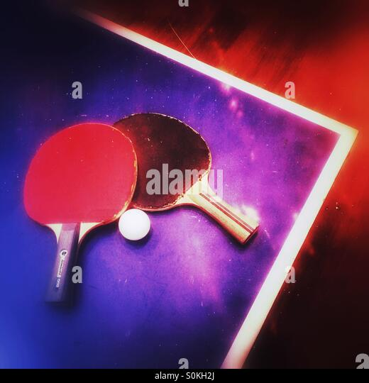 Two table tennis bats on a table - Stock Image