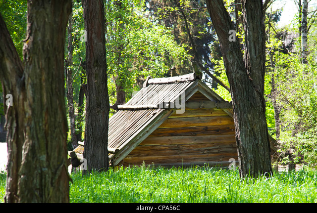 Wood cabin forest stock photos wood cabin forest stock for Old style cabins