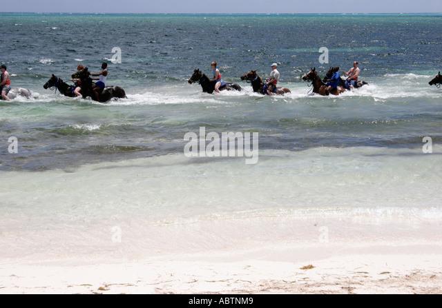 Grand Turk Atlantic Ocean Indigenous Horse Shelter horseback riding surf - Stock Image