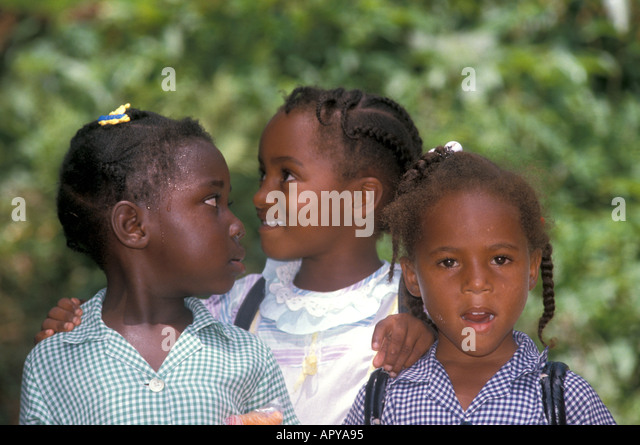 Jamaica School Girls looking at each other - Stock Image