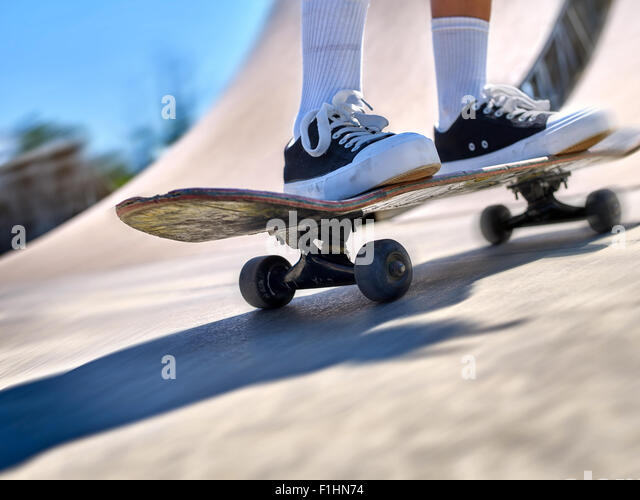 Legs skateboard close up  in skate park. Low section. - Stock-Bilder