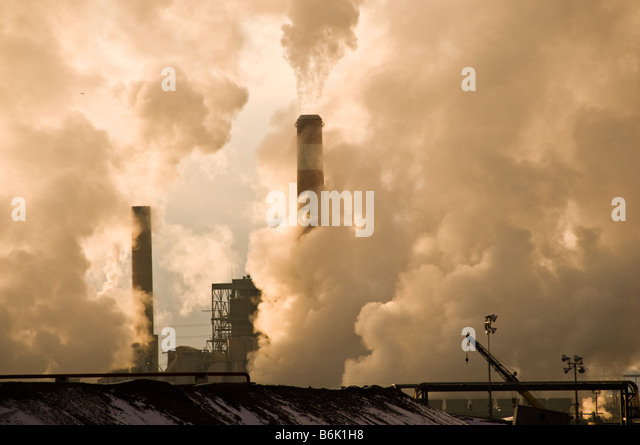 Oil and gas refinery smokestacks - Stock Image