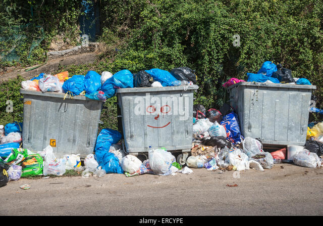 Overflowing rubbish bins waiting to be emptied, Outer Mani, Messenia, Peloponnese, Greece. - Stock Image