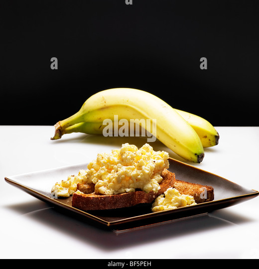 low calorie healthy choice of banana and eggs on toast - Stock Image