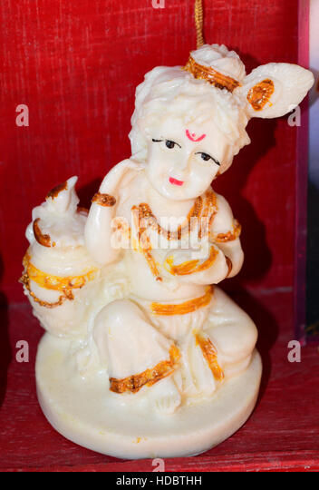 Child Krishna holding Butter Beautiful Handcrafts Statue India - Stock Image