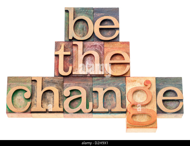 be the change - inspiration concept - isolated text in vintage letterpress wood type printing blocks - Stock Image